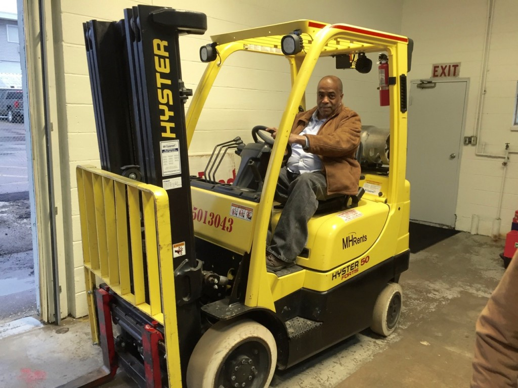 Joe Davenport operates the forklift, donated by MH Rents in Cross Lanes, at the UFO distribution center.
