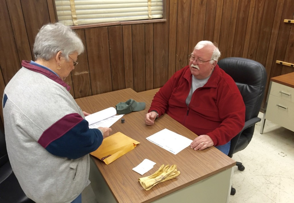 UFO Treasurer Kay Moffat and volunteer Joe Gresham, who supervises food distribution operations at the building, break in the new office space.